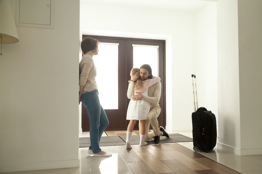 Father Leaving, Hugging Daughter