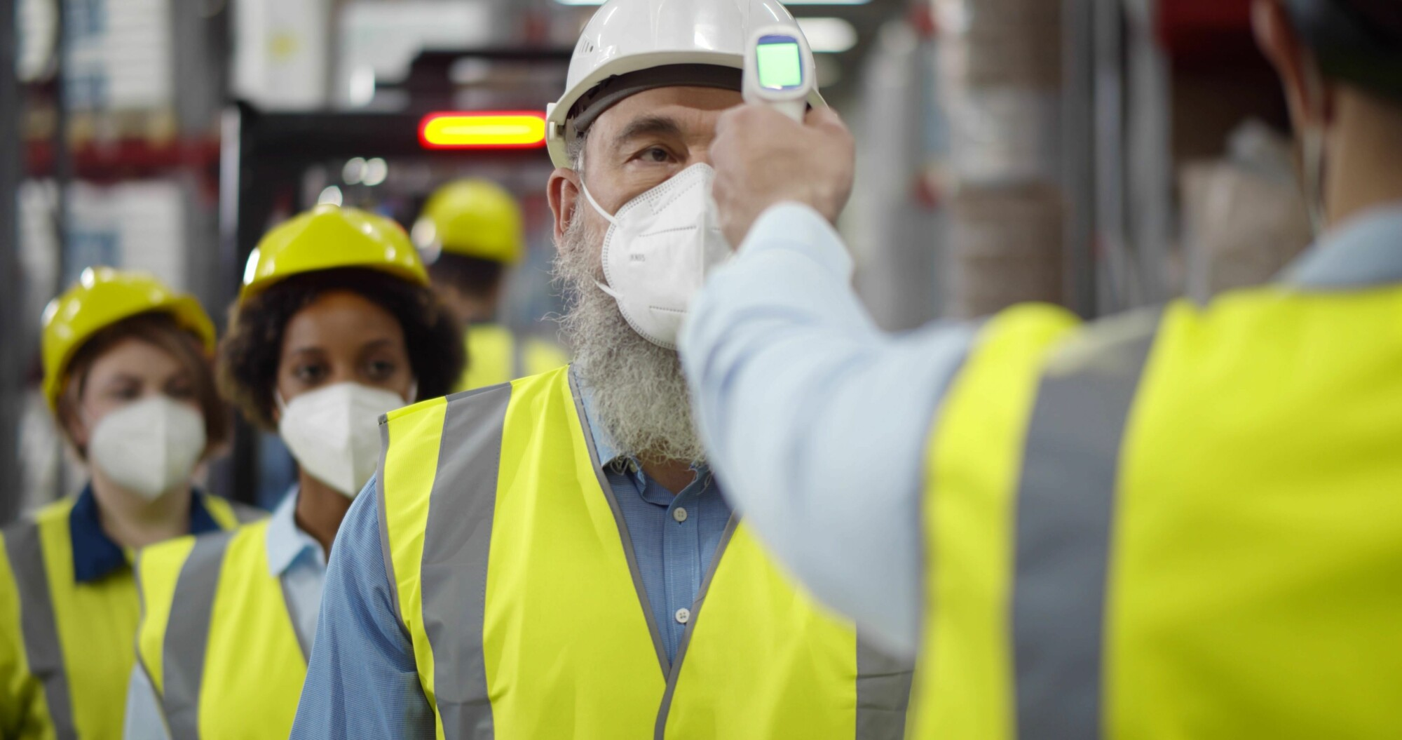 Warehouse Workers Checking Temperatures
