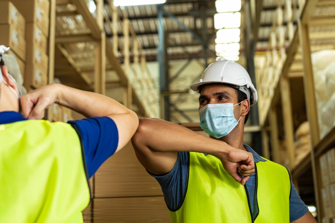 Masked Workers in Warehouse